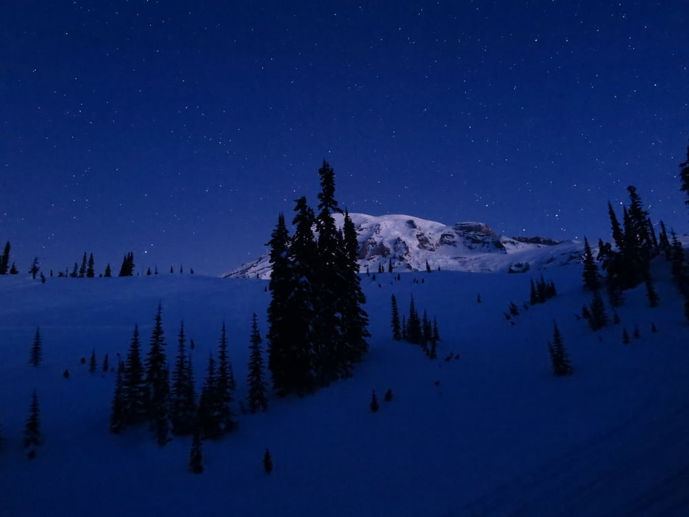 Darkness and morning stars over Mt. Rainier.