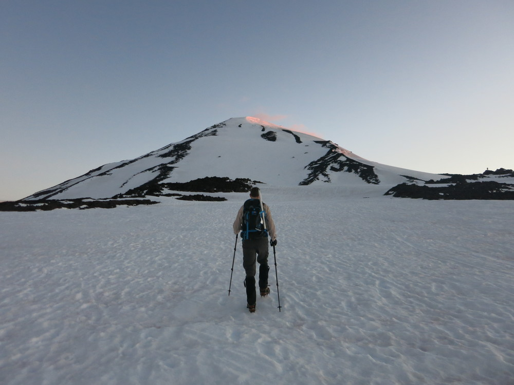 Aaron walking towards the snow slope that leads to Piker's Peak, the false summit of Mt. Adams.