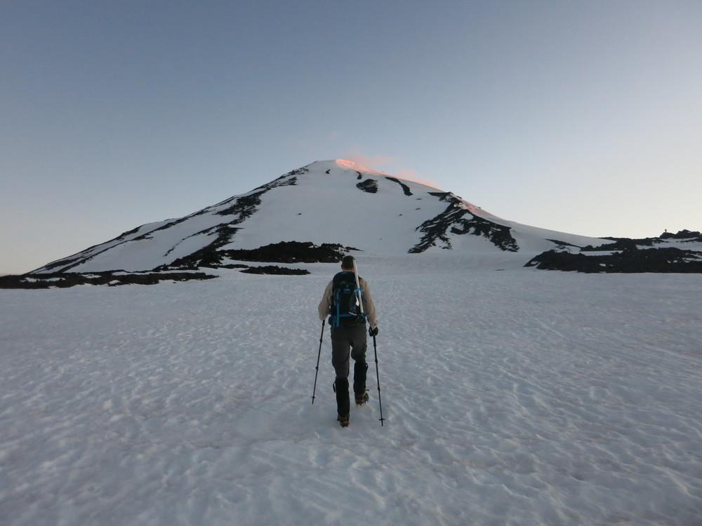Aaron walking towards the snow slope that leads to Piker's Peak, the false summit of Mt. Adams.