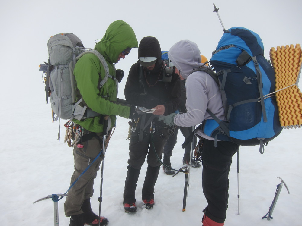 Checking the map in whiteout conditions.