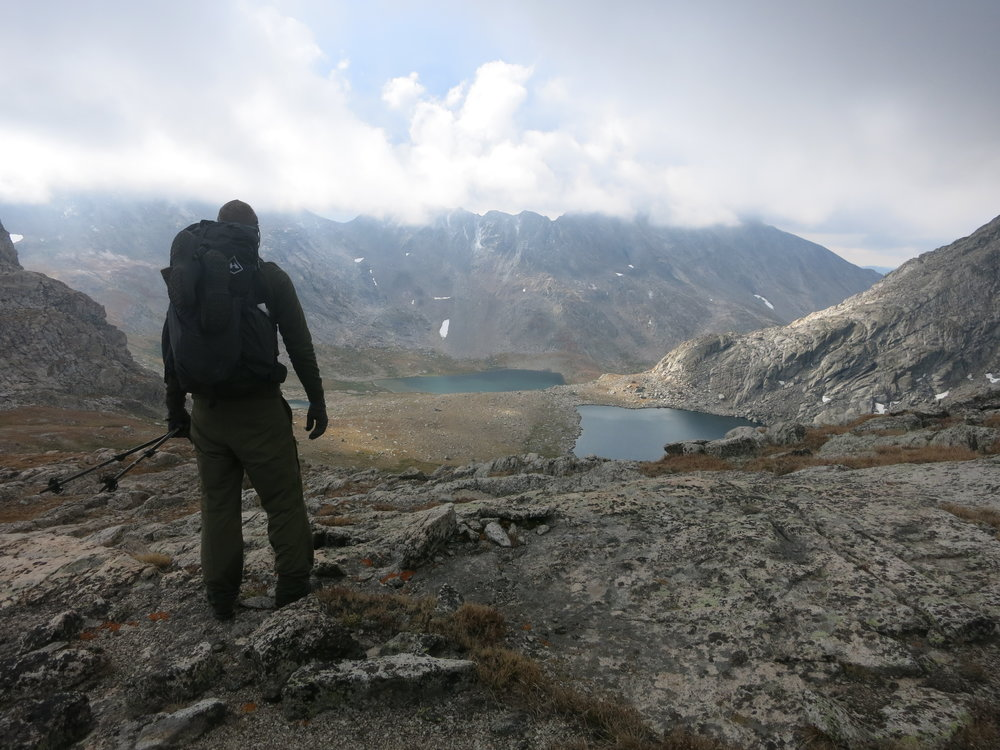 Looking down to a lake basin, below the base of Europe Peak.