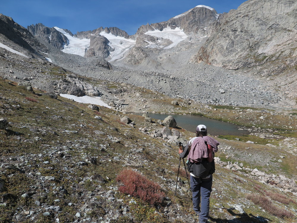 Heading down the Blaurock Pass, en route West Sentinel Pass. The route goes up the massive moraine in front of me and makes a right up the gully visible below Gannett Peak (the domed peak with snow on the top).