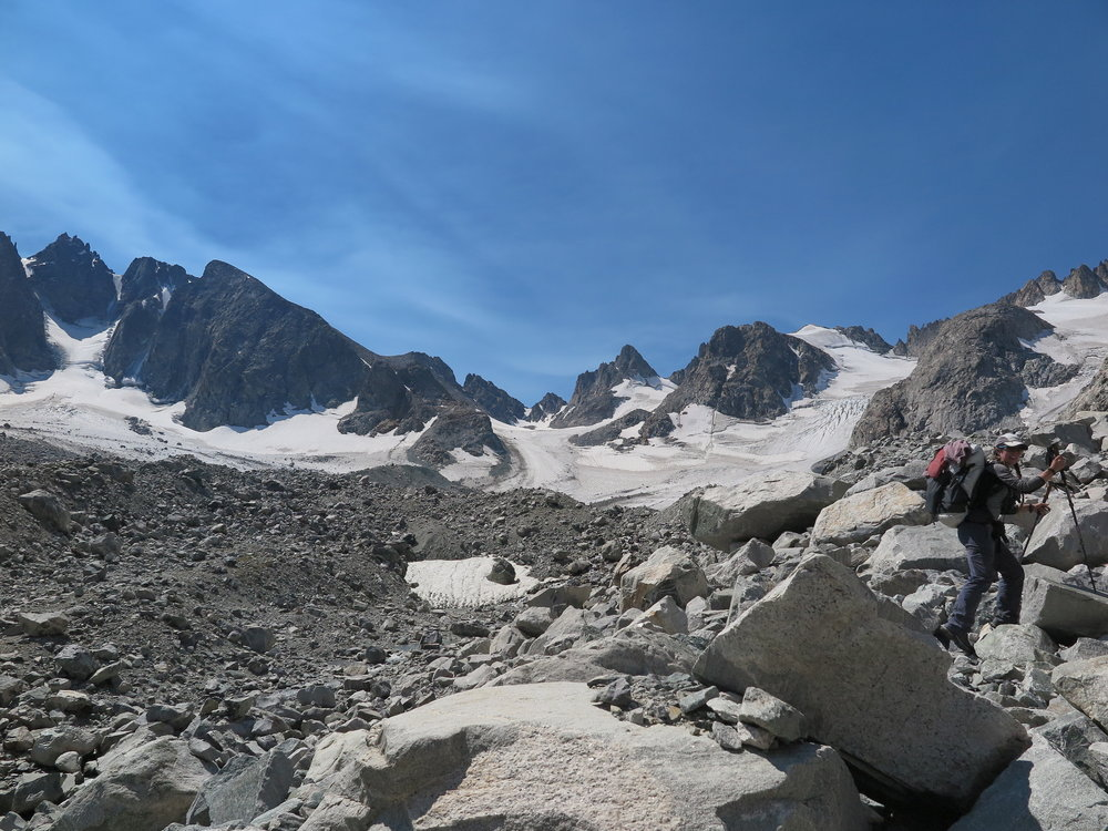 Starting up the moraine towards West Sentinel Pass. Dinwoody Glacier in the distance.