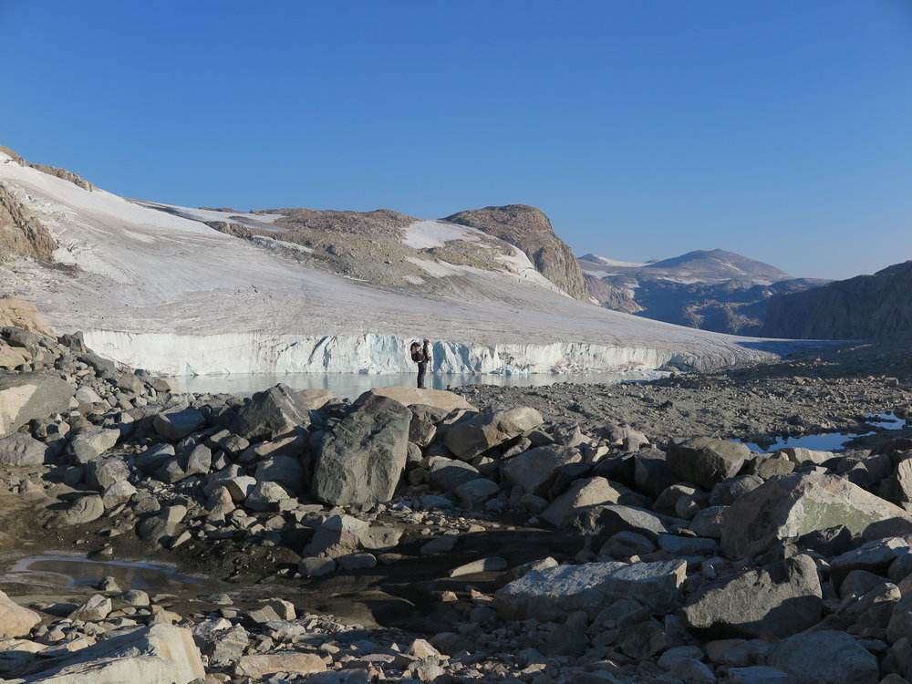 Standing on the rocks in front of the Grasshopper Glacier.