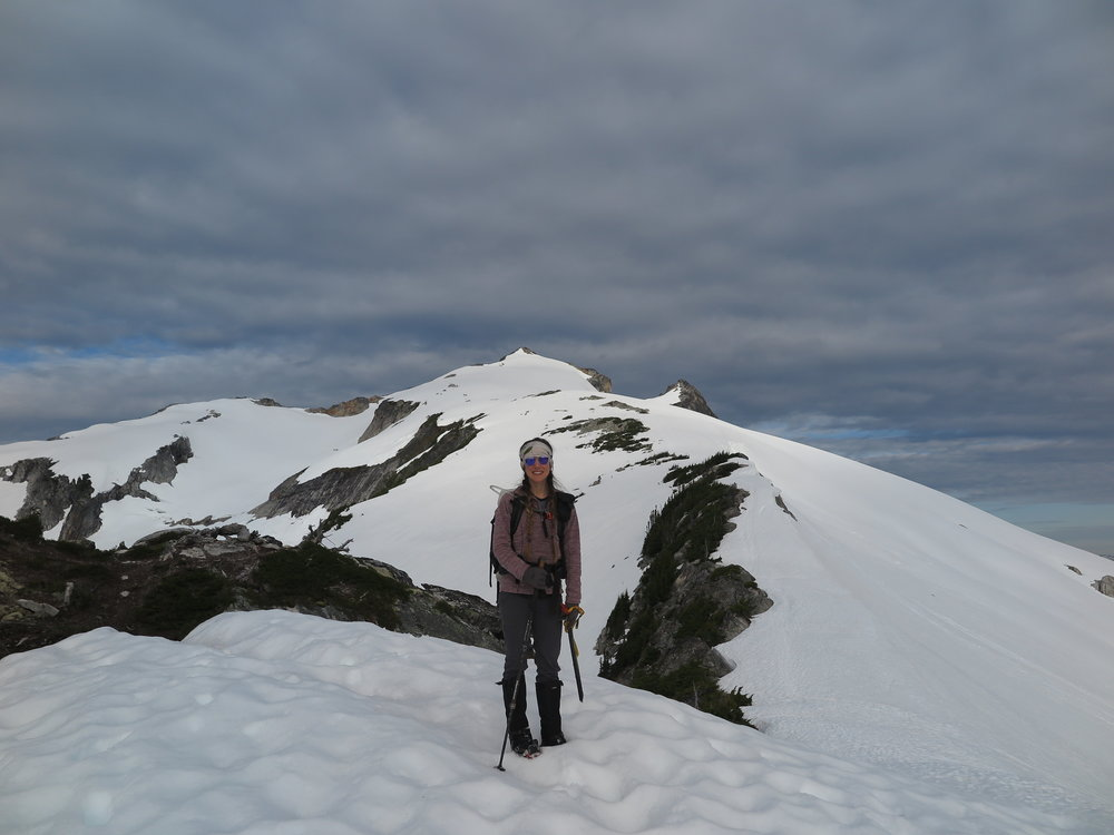 About to descend a steepish snow slope on Snowking Mountain in the North Cascades: pole in one hand, ice axe in the other.